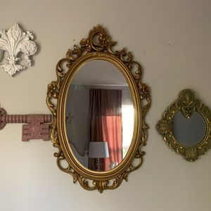 Vintage ornate oval mirror wall hanging gold color Victorian classic shabby chic